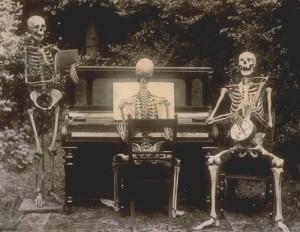 Three Skeletons Playing Music